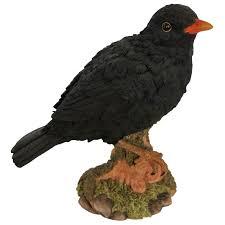 blackbird on tree garden ornament the garden factory