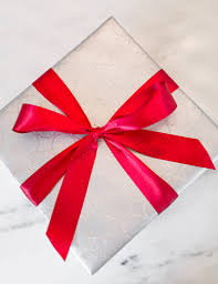 best gift wrap a perfectly wrapped present how to wrap a gift and tie a bow