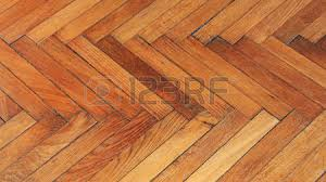 reclaimed used wooden parquet flooring pattern stock photo