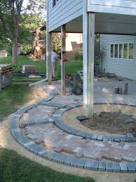 improve your basement walkout with a paver patio grove landscaping