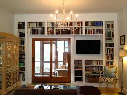 Library Bookcases With Ladder White Wall Books Shelves Combined With Television Also Glass Door