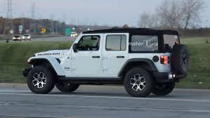jeep wrangler 4 door top off spy spots released of new re designed 2018 jeep wrangler on street