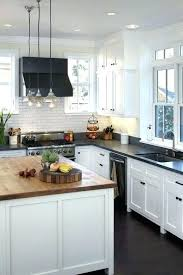 white kitchen cabinets with black countertops white cabinets counters light cabinets counter oak