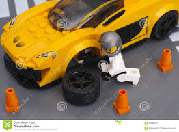 lego mclaren lego driver is fixing wheel of mclaren p1 by lego speed champion