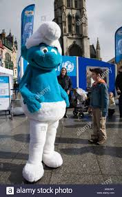 a smurf character campaigns for unesco programme in saint bavos sq