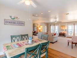 beach front cottage with spacious living room screened porch