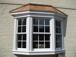 exterior brown brick and white bay windows lowes for home