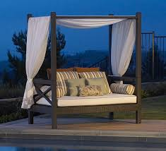 modern outdoor rectangular canopy with a canvas shell and a set of