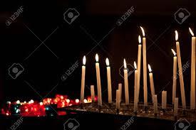 vigil lights catholic church many burning prayer candles in catholic church stock photo picture