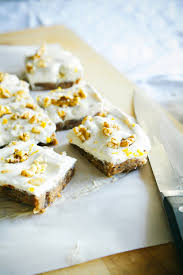 raw carrot cake slice with tangy citrus frosting the first mess