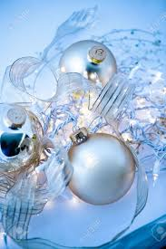 an abstract tangle of glowing silvery christmas ornaments with
