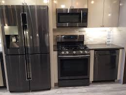 gray kitchen cabinets with black stainless steel appliances backyard ideas kitchens with stainless appliances