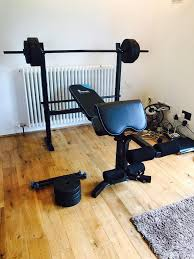 men u0027s health folding workout bench with 35kg weights in