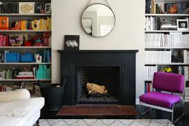 how to live like a fashion insider homes offices runway design bookshelves flanking a fireplace in lauren goodman s home