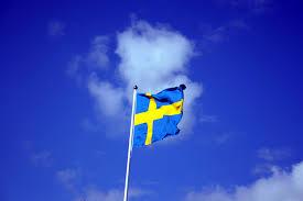 Sweedish Flag File Swedish Flag With Blue Sky Behind Jpg Wikimedia Commons