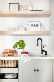 kitchen cabinet sink faucets light gray pantry cabinets with matte black faucet cottage