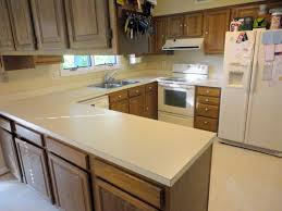 decorating awesome wooden kitchen cabinet with white corian vs