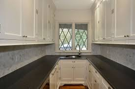 Carrara Marble Laminate Countertops - traditional pantry with laminate floors by jeffrey grasso zillow