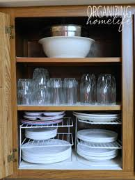 how do you arrange dishes in kitchen cabinets organizing dishes how to organize your kitchen frugally