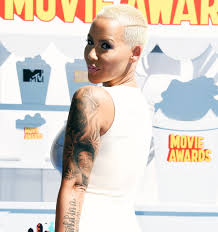 amber rose covers tattoo of ex wiz khalifa with another man