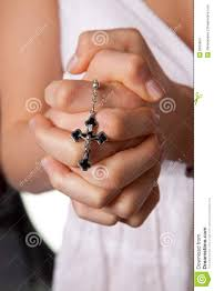 praying with cross praying stock photo image of