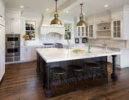 white kitchen cabinets with black island kitchens by deane two tone cabinets island with white