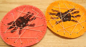 halloween kids craft handprint spiders in a diy lacing card web