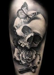 skull and butterflies s arm tattoomagz