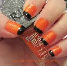 halloween french tip manicure with orange and black polishes
