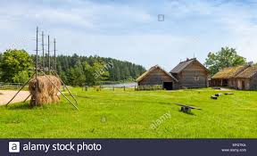 Landscape With Houses by Russian Rural Landscape With Old Wooden Houses And Barns On Green