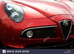 alfa romeo 8c the front grill and badge of a red alfa romeo 8c competizione
