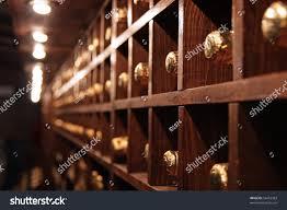 racks bottles dark wine cellar stock photo 54418363 shutterstock
