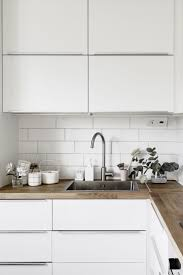 white wood kitchen cabinets best 25 white tile kitchen ideas on pinterest subway tile
