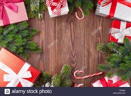 christmas gift boxes and fir tree branch on wooden table top view