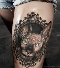 70 sweet cat tattoos on thigh