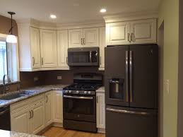 white kitchen cabinets with black slate appliances ge slate appliances the look of the slate appliances