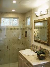 a decorative tiled shower with frameless glass door nott