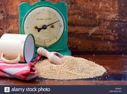 Vintage Kitchen Scales Pile Of Quinoa Grain With Wooden Scoop With Vintage Kitchen Scales