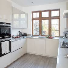 small square kitchen ideas grey modern kitchen with handleless cabinetry and pink splashback