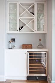 a clean and organized dry bar is a great option for a small nook