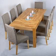 rectangle long brown wooden table with four legs plus gray fabric