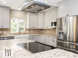what color backsplash with white quartz countertops waypoint cabinets in harbor color with rubbed bronze