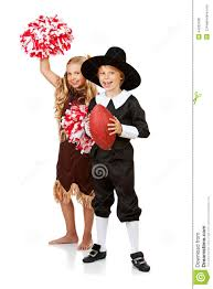 thanksgiving indian costume thanksgiving pilgrim and indian are football fans stock photo