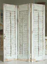 vintage window shutters repurpose tip junkie shutter up shutters in a distressed state distressed shutters