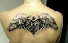women upper back cover up with gear parts heart tattoo design