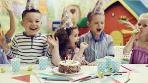children blowing out candles on birthday cake stock footage video