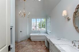 white and gray master bath with hexagon terracotta floor tiles