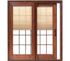 Pella Patio Screen Doors This Wood Patio Door Set From Pella Is An Elegant Twist On The