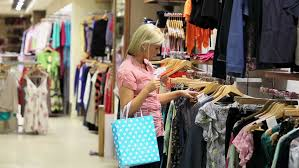 for clothes friends happily shopping together in clothing store stock footage