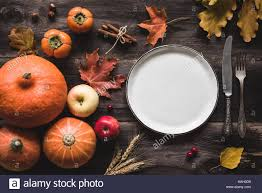 autumnal table setting for thanksgiving dinner empty plate